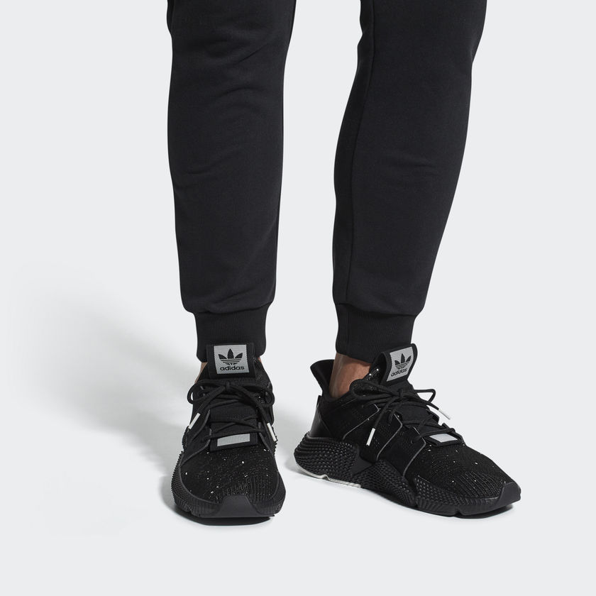 09ac35d91f6 The Prophere s knitted construction offers a sock like fit which hugs the  foot for support and showcases some serious adidas tech.